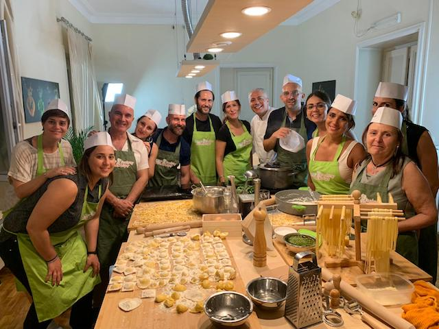 A-group-of-italian-people-cooking-at-rome-cooking-workshops.jpg